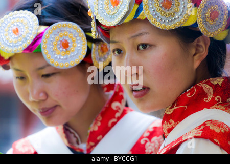 Two young Naxi women in traditional costume in Lijiang old town, Yunnan Province, China. JMH4769 - Stock Photo