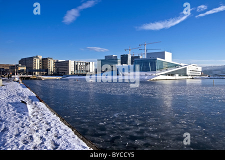 Winter view of The Oslo Opera House In Bjørvika in the centre of Oslo Norway at the head of Oslofjord - Stock Photo