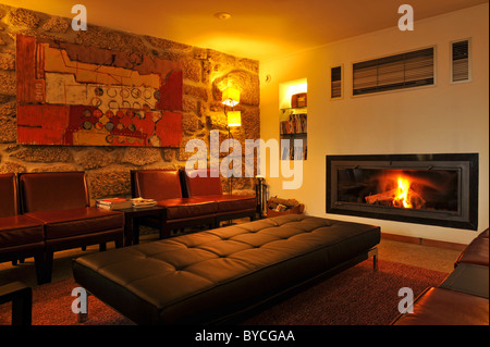 Cosy living room with panoramic fireplace - Stock Photo
