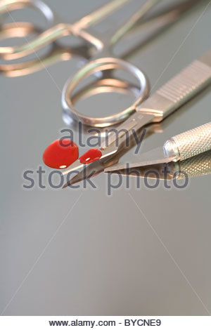 Scalpels with blood - Stock Photo
