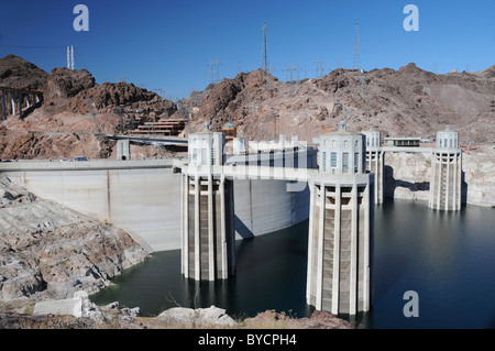 Hoover Dam concrete arch-gravity dam in Black Canyon of the Colorado River on the border between Arizona and Nevada - Stock Photo