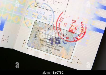 Turkey Visa in passport - Stock Photo