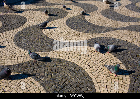 These calçadas aka Portuguese pavement, a wave pattern in Rossio Square, were the first in Lisbon. - Stock Photo