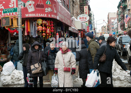Chinatown in New York is bustling on Saturday, January 29, 2011 prior to the arrival of Chinese New Year. - Stock Photo