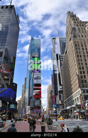 The Historic Times Square in New York City with tall billboards advertising well known brands. - Stock Photo