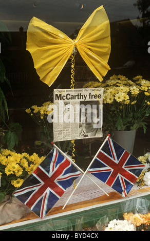Newspaper cutting, yellow ribbon and Union Jack flags mark the release of Beirut hostage, the TV journalist John - Stock Photo