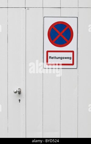 No parking sign on an emergency exit, lettering 'Rettungsweg', German for 'escape route' - Stock Photo