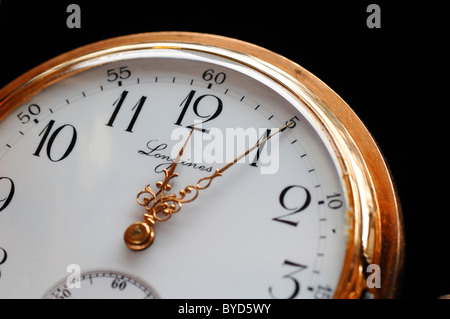 Longines gold plated pocket watch, five past twelve, 19th century - Stock Photo