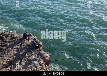 Fisherman, Boca do Inferno or Hell's Mouth chasm, Cascais, Lisbon District, Portugal, Europe - Stock Photo
