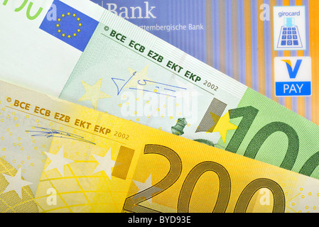 Euro banknotes, bills fanned out, bank card, cash card with the latest icons, V-PAY, VPAY, girocard - Stock Photo