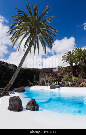 Swimming pool in the lava cave, Jameos del Agua, built by the artist Cesar Manrique, Lanzarote, Canary Islands, - Stock Photo