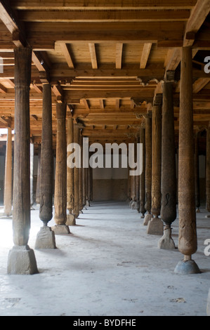Wooden pillars in the Juma mosque, Khiva, Uzbekistan, Central Asia - Stock Photo