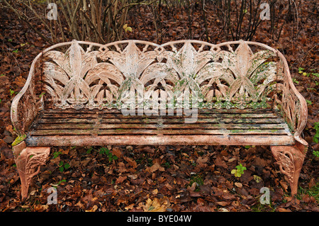 Fine cast iron garden bench covered in autumn leaves, Villa & Ambiente, Nuremberg, Middle Franconia, Bavaria, Germany, - Stock Photo