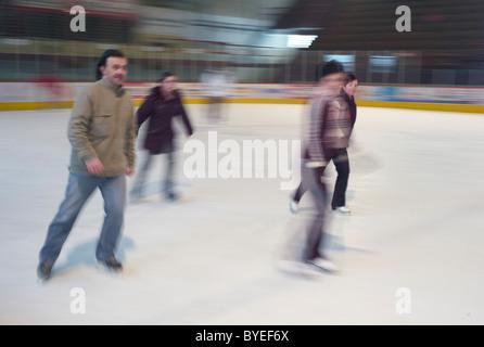 Skaters on an ice rink in Novey Zamky Slovakia - Stock Photo