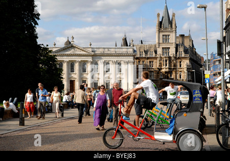 Bicycle taxis outside colleges in the old city of Cambridge, Cambridgeshire, United Kingdom - Stock Photo