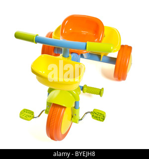 Vibrant child's 1st bike / trike isolated on white. - Stock Photo