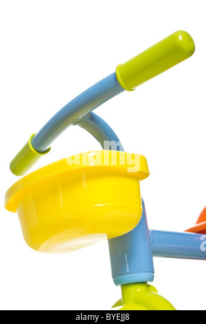 Vibrant child's 1st bike / trike isolated on white abstract. - Stock Photo