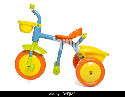 Vibrant child's 1st bike / trike isolated on white. - Stock Photo