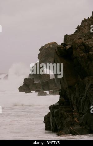 Waves crashing over rocks on Dalmore or Dail Beag beach, Isle of Lewis, Outer Hebrides, Scotland, UK - Stock Photo