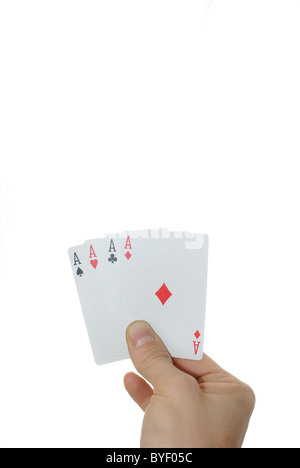 Four aces in a hand isolated on a white background. - Stock Photo