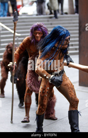 Cast members from Cirque du Soleil's Totem recreated Darwin's iconic evolution of man scene in Liverpool Street. - Stock Photo
