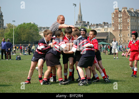 Primary school children playing in a rugby tournament at Bath, UK - Stock Photo