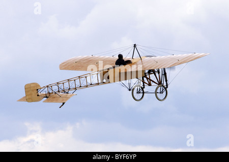 Bleriot XI Flyer plane replica climbing after take off at Duxford Flying Legends Airshow - Stock Photo