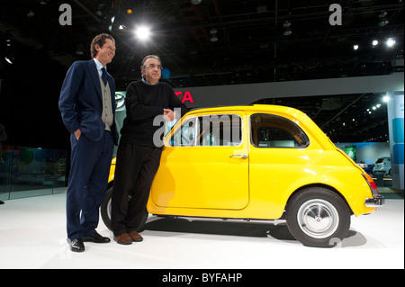 Fiat Chairman John Elkann and Fiat and  Chrysler CEO Sergio Marchionne with a vintage Fiat 500 at NAIAS 2011 in - Stock Photo