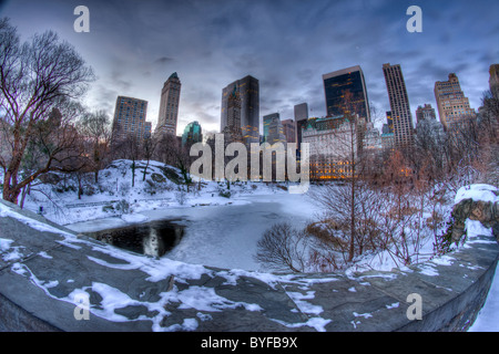 Fisheye View of the Pond from Gapstow Bridge in Central Park at Dawn on a Snowy Morning - Stock Photo