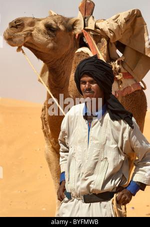 Camel driver with camel on Sahara desert, Mauritania - Stock Photo
