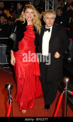 Nick Rhodes and Meredith Ostrum The Orange British Academy Film Awards (BAFTAs) after-party held at Grosvenor House - Stock Photo