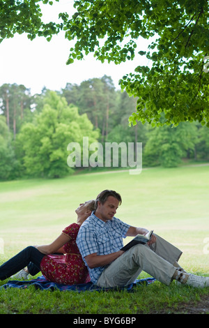 Young couple relaxing in park - Stock Photo