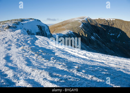 Winter on the Helvellyn ridge looking towards Nethermost Pike, Lake District, Cumbria - Stock Photo