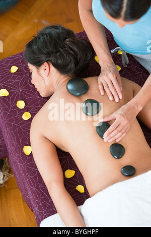 Woman having lastone therapy at health spa - Stock Photo