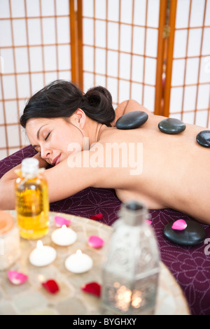 Woman having lastone therapy at health spa - Stock Photo
