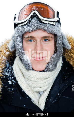 Studio portrait of young man in ski-wear - Stock Photo