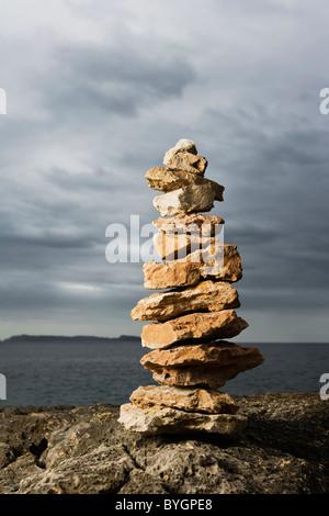 Stacked stones near sea - Stock Photo