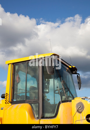 Cabin of the Volvo L180F front loader - Stock Photo