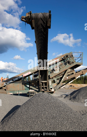Powerscreen Turbo Chieftain 1400 screening device with conveyor belt at a rock quarry , Finland - Stock Photo