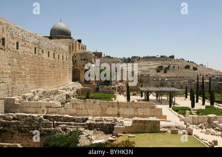 Rebuilt ruins outside the old city wall of Jerusalem, Israel with the Mount of Olives in the background. - Stock Photo