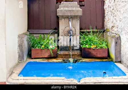old fountain in a small town in Southern Germany, Brunnen in Staufen - Stock Photo