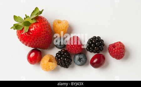 Agriculture - Mixture of berries: strawberry, red and golden raspberries, blackberries, blueberries and cranberry, - Stock Photo
