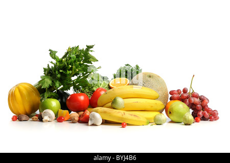 Assortment of fresh fruits and vegetables isolated over white background - Stock Photo