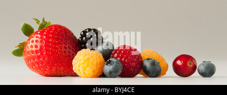 Agriculture - Mixture of berries: strawberry, red and golden raspberries, blackberry, blueberries and cranberry, - Stock Photo