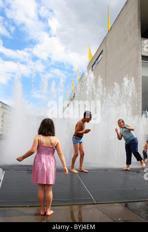 children playing in the fountain at London's Southbank - Stock Photo