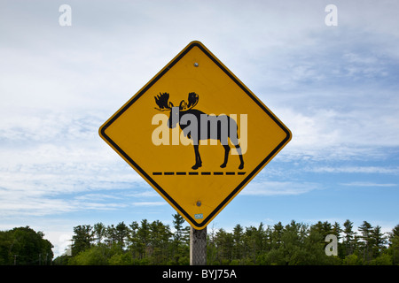 USA, Maine, Warren, Moose Crossing warning sign along US Route 1 - Stock Photo