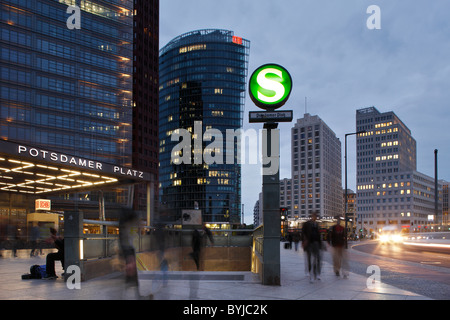 Building facades and the S-Bahn entrance in Potsdamer Platz, Berlin, Germany - Stock Photo