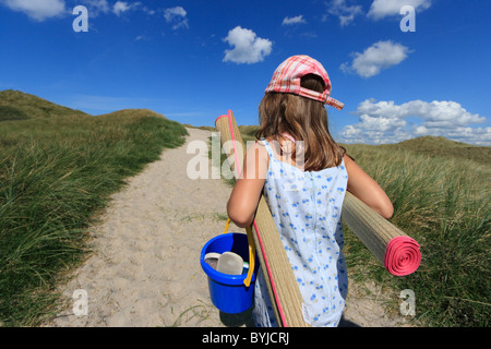A girl on the way to the beach - Stock Photo