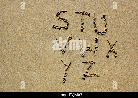 The letters S-Z written out in wet sand. Please see my collection for more similar photos. - Stock Photo