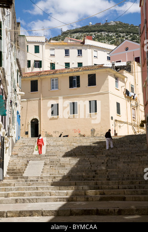 Typical traditional Gibraltar street / streets / road, with steep large / flight of stares leading up the hill towards - Stock Photo